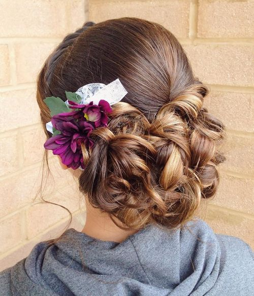 low curly updo with flowers