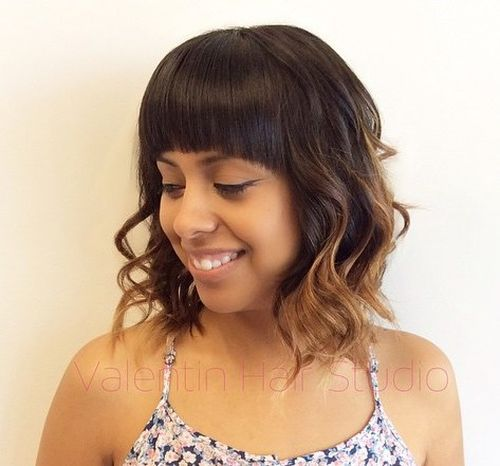 long wavy bob with caramel ends and arched bangs