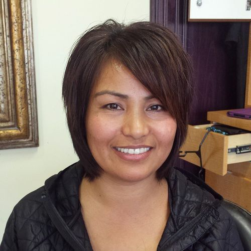 chin-length bob with layers and side bangs