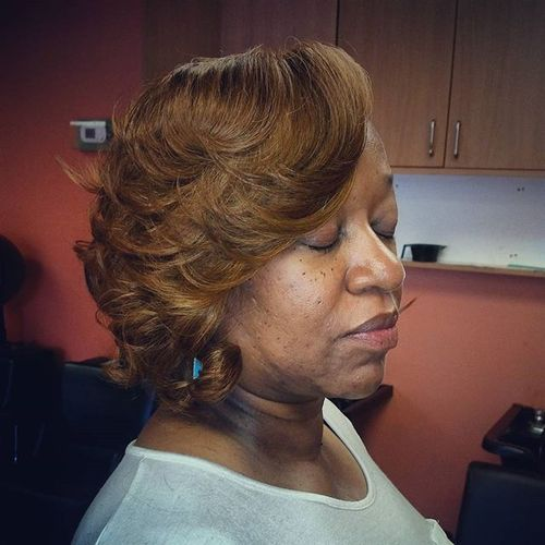 short hairstyle with flicks for black women