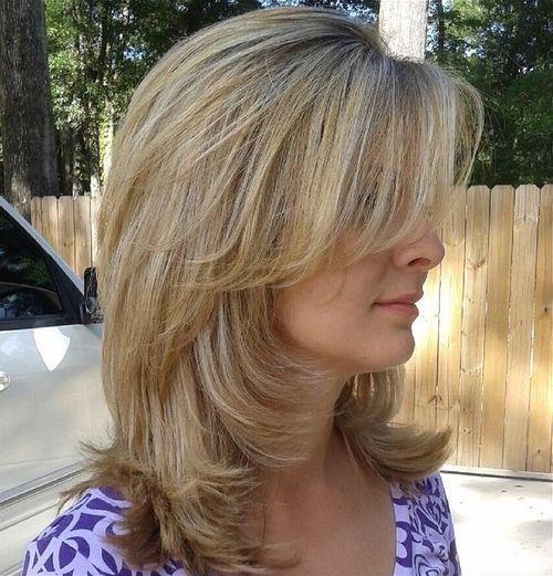 medium layered haircut with side bangs