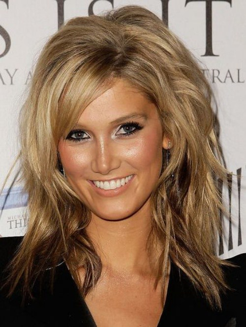 mid-length layered haircut with side bangs